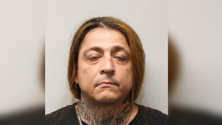 Cover for Tewksbury police arrest man wanted for assault to murder charge in motel parking lot