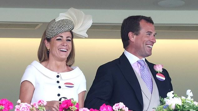 Picture for The smile that says 'I'm single'! Peter Phillips looks cheerful as he joins family friend Natalie Pinkham at Royal Ascot in first appearance since divorce from wife Autumn was finalised