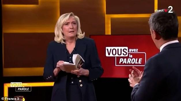 Picture for French far-right leader Marine Le Pen is left stunned as President Macron's interior minister accuses HER of being 'too soft' on Islam in election debate