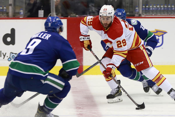 Picture for FLAMES FALL TO CANUCKS