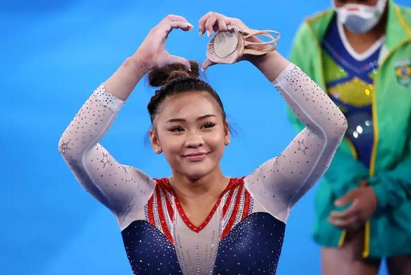 Picture for Sunisa Lee didn't owe the U.S. gold. Her victory is a gift, especially to her Hmong community.