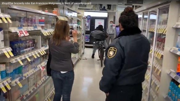 Picture for San Francisco thief fills trash bag with Walgreens items as security guard records him, then cruises off on bike