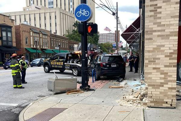 Picture for Driver crashes into 2 poles, restaurant in Lakewood