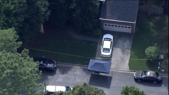 Picture for Manhunt underway for man possibly involved in killings of two found dead in Roswell home, police say