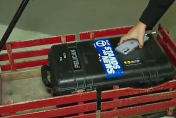 Picture for Video falsely claims possible voter fraud in Detroit. It actually shows a WXYZ photographer loading camera gear.