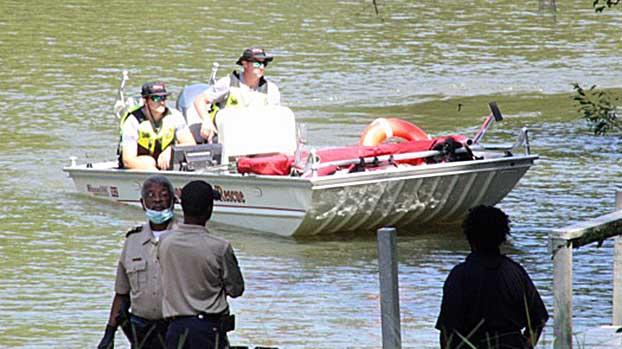 Cover for Alabama fisherman reels in pants with bones, wallet of fugitive missing since 1989