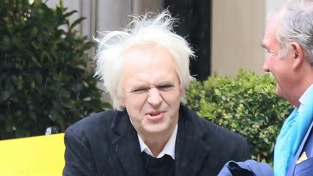 Picture for Save a hair for me now! Duran Duran star Nick Rhodes struggles to keep his unruly locks under control after being caught in a gale during alfresco lunch