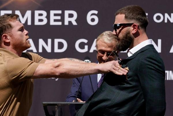 Picture for Canelo Alvarez, Caleb Plant trade punches at news conference for Nov. 6 title unification bout