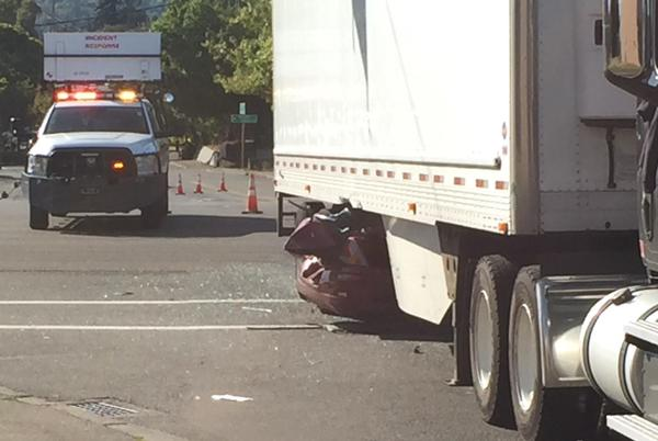 Picture for Car flees traffic stop, runs red light, slams under semi