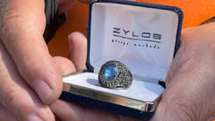 Cover for Maine metal-detecting enthusiast finds class ring missing for 37 years