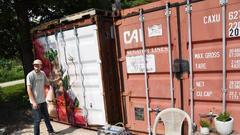 Cover for Growth industry: Libertyville man plants urban farm in old shipping container