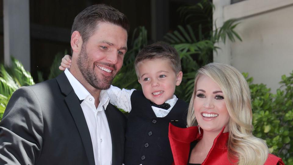 Carrie Underwood Is Head Over Heels For Her Family See Their