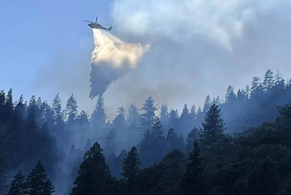 Picture for River fire sweeps into communities; dozens of homes destroyed and thousands evacuated