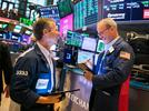 Picture for Dow rises 200 points to a record despite disappointing economic data