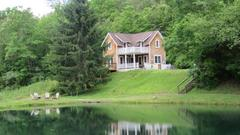 Cover for The Charming Waterfront Green Valley Cottages In Pennsylvania Are Calling Your Name This Summer