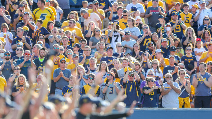 Cover for Watch: West Virginia football fans brawl in the stands during Virginia Tech game