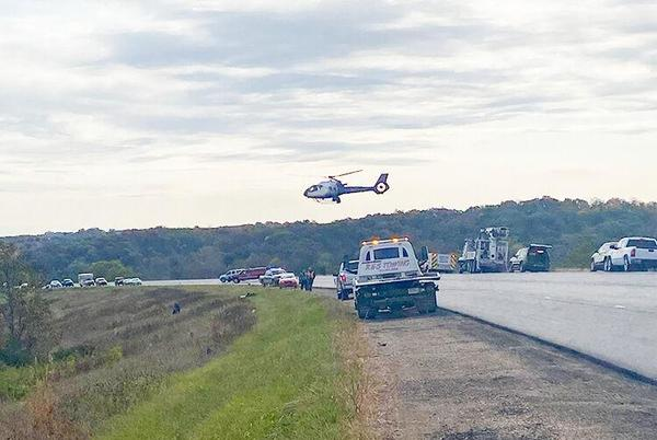 Picture for Morning roll-over claims young mother, young children survive