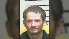 Cover for Kentucky man found under trap door faces drug charges