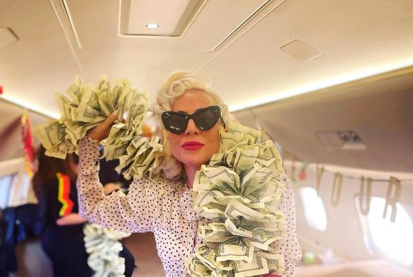 Picture for 'Vegas Baby!' Lady Gaga Wears Boa Made of $100 Bills and Pink Hermès Kelly on Private Jet