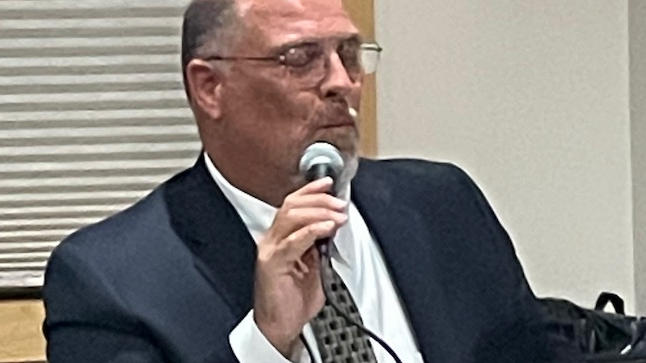 Cover for Strnad and Monroe Face Off In Marion City Council Candidate Forum