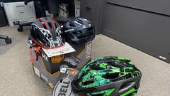 Cover for Health Department to give away free helmets