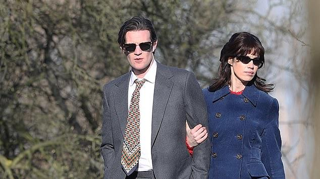 Picture for Matt Smith cosies up to actress Gala Gordon as they cruise in Noel Gallagher's retro £110K Jaguar for the rock star's new music video