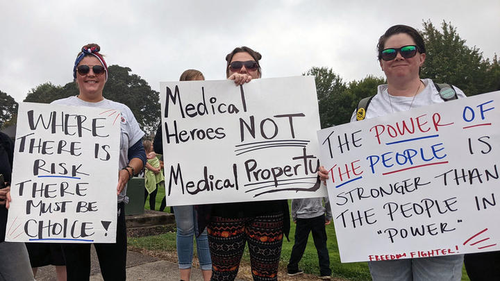 Cover for Area residents rally to protest coerced vaccinations