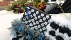 Cover for Wife of Utah police officer who died from COVID-19 says her family will get vaccinated