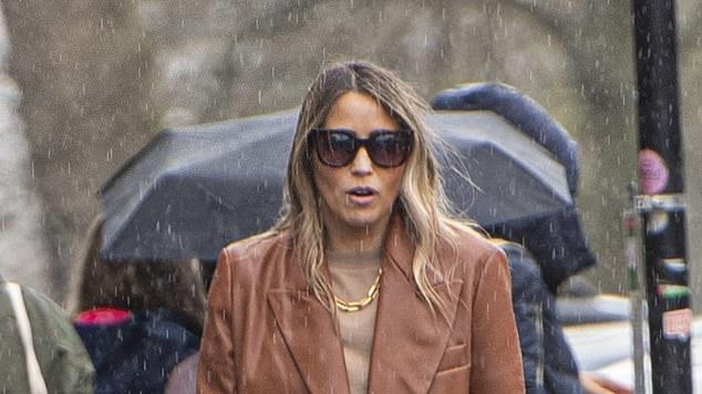 Picture for Rachel Stevens, 42, showcases her chic style in an oversized leather blazer with a £945 Saint Laurent tote as she gets stuck in the rain