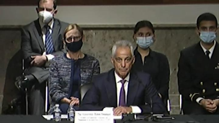Cover for Who was man in uniform behind former Chicago Mayor Rahm Emanuel at senate hearing?