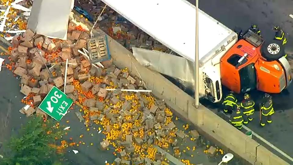 Picture for Tractor trailer overturns spilling vegetables on Brooklyn Queens Expressway