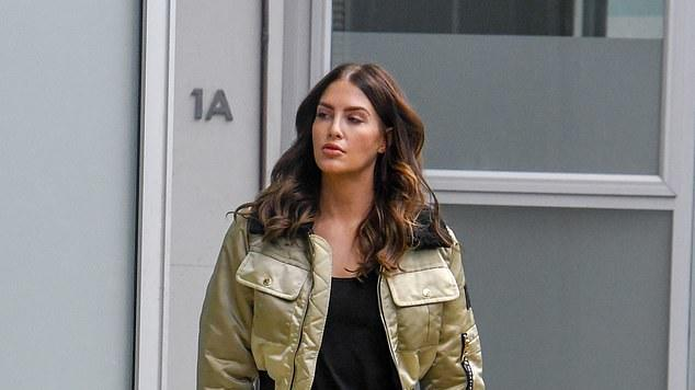 Picture for Erin Holland leaves a hair salon in Sydney as she tries to keep herself distracted while her new husband Ben Cutting isolates in Covid-ravaged India just two months after their wedding