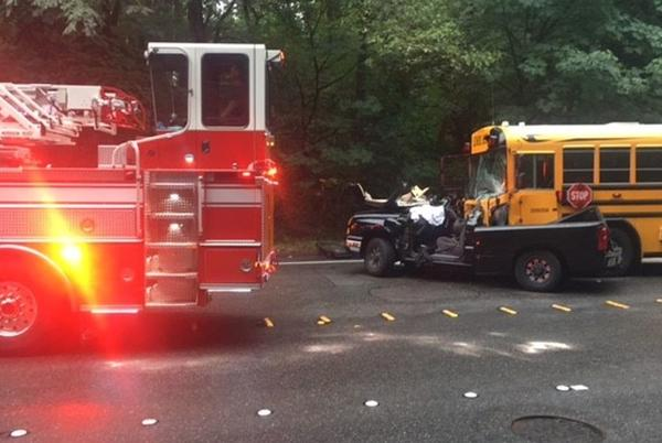 Picture for Driver extricated after truck slams into school bus