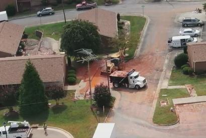 Picture for 'It was like a flood': Neighbors react to water main break, sinkhole in downtown Asheboro near City Hall