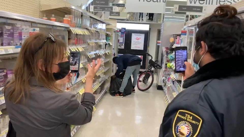 Picture for Thief steals items from SF Walgreens with security filming in plain sight