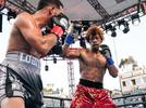 Picture for Photos: Gary Antuanne Russell Beats Down Jovanie Santiago For Stoppage Win