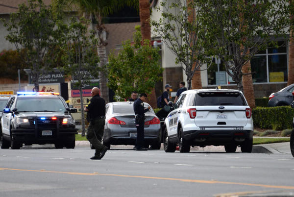 Picture for School safety officer fires on car near Millikan High; one person critically wounded