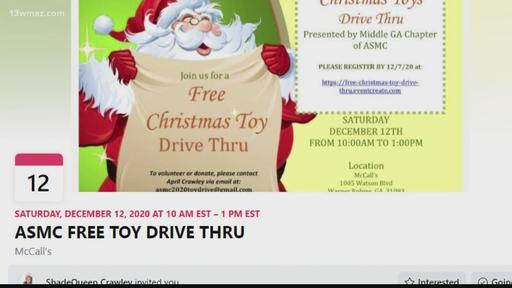 Group from Robins Air Force Base holding drive thru toy giveaway