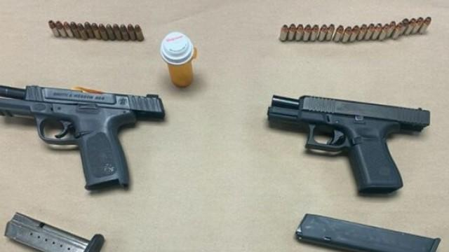 Cover for Two men arrested on weapons, drug charges after a traffic stop