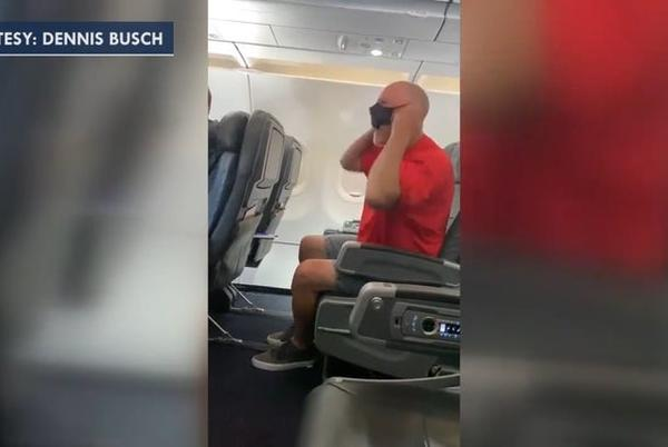 Picture for Couple in viral video kicked off JetBlue flight over refusal to wear masks, berating staff, airline says