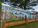 Picture for New Old Town mural designed by kid shows city's past and imagines its future