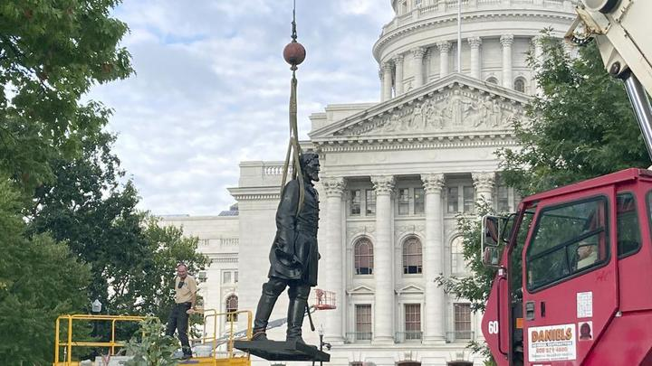 Cover for Workers reinstall Wisconsin statues downed in 2020 protest