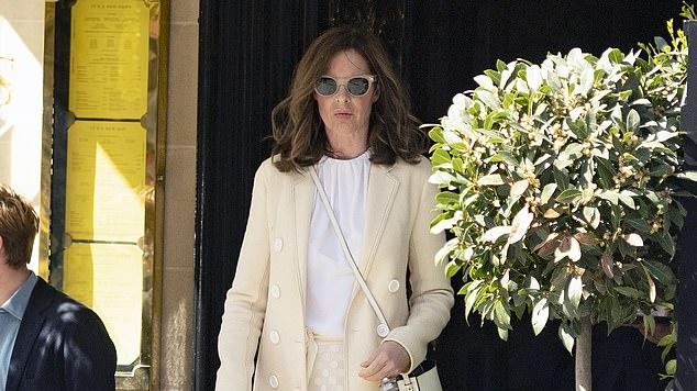 Picture for Trinny Woodall, 57, looks chic in a cream coat and skirt combo as she joins partner Charles Saatchi, 77, for lunch at their favourite place Scott's