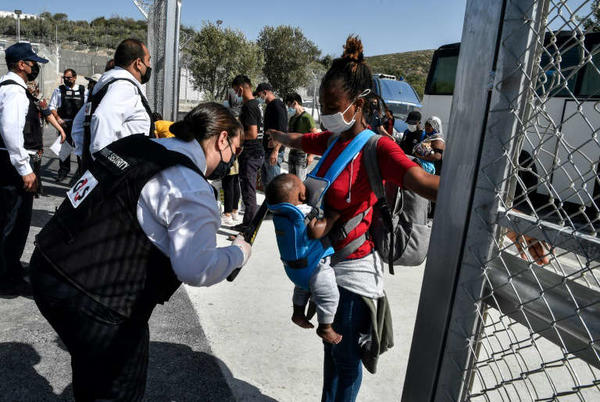 Picture for Greece begins moving migrants to new 'closed' camp