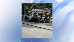 Cover for Car bursts into flames after crashing with motorcycle in Raleigh