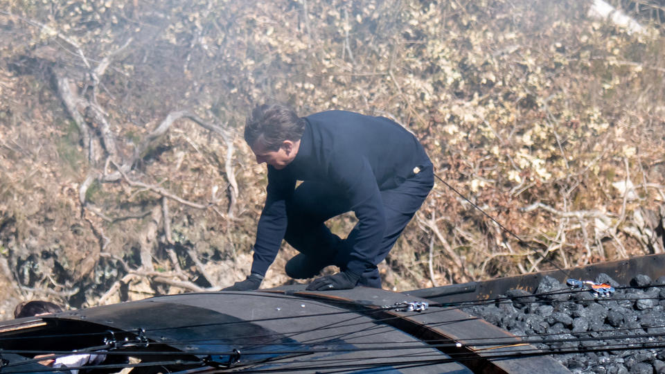 Picture for Tom Cruise and Hayley Atwell do their own terrifying stunts as Mission Impossible stars run along roof of a moving train