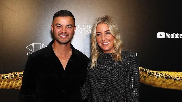 Picture for Guy Sebastian dons a sleek all-black ensemble at the APRA Music Awards alongside wife Jules who dazzles in a power suit adorned with crystals