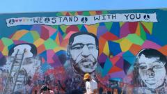 Cover for Portland mural honoring George Floyd, Breonna Taylor and Ahmaud Arbery defaced with white supremacist graffiti