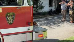 Cover for Crews fight house fire; home considered 'total loss'