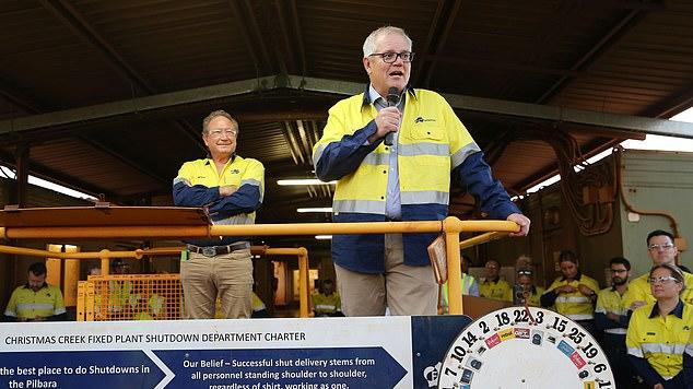 Picture for Scott Morrison calls in help from mining magnate Andrew Forrest to smooth over tensions with China - after the billionaire was allowed to come and go from Australia to close iron ore deals